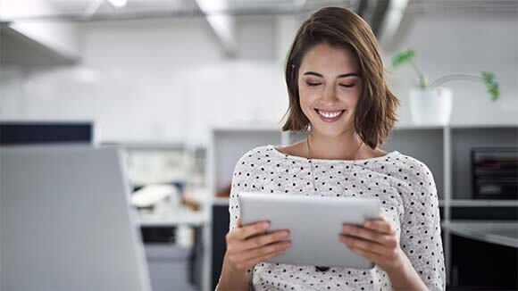 smiling-woman-on-ipad
