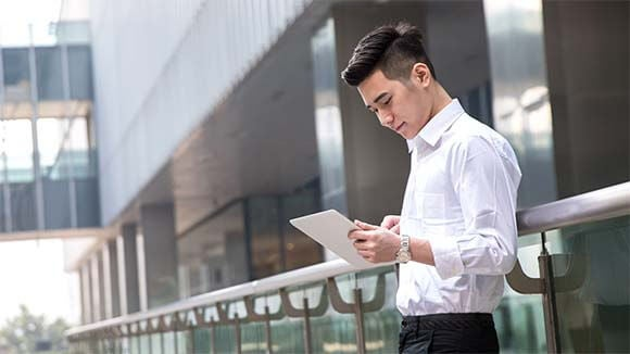 asian business man using tablet